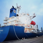 A dock view of a large cargo ship in port.
