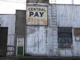 Street view of a old store sign at the port.