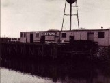 Boat view of the Port's Wharf and Water Tower.