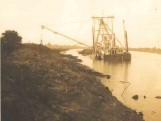 A large ship dredging the shore for Port of Stockton