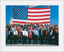 History and e-tour of a Stockton 1990's Group picture of government officials in front of American Flag